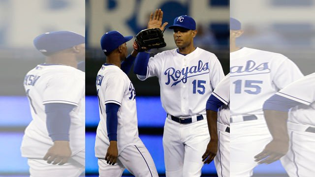 Kansas City Royals left fielder Jarrod Dyson, left, celebrates with right fielder Alex Rios (15) following their 3-0 win over the Toronto Blue Jays in a baseball game at Kauffman Stadium in Kansas City, Mo., Friday, July 10, 2015. (AP Photo/Orlin Wagner)