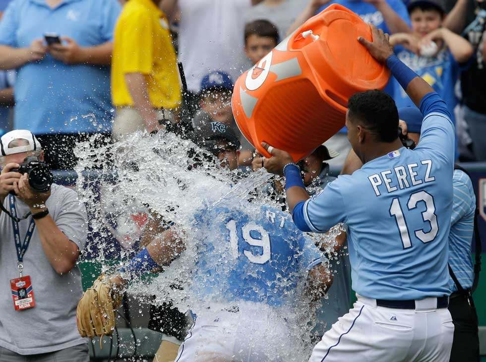 Kansas City Royals' Salvador Perez (13) dumps water on teammate Cheslor Cuthbert (19) following a baseball game against the Tampa Bay Rays at Kauffman Stadium on July 9 (AP)
