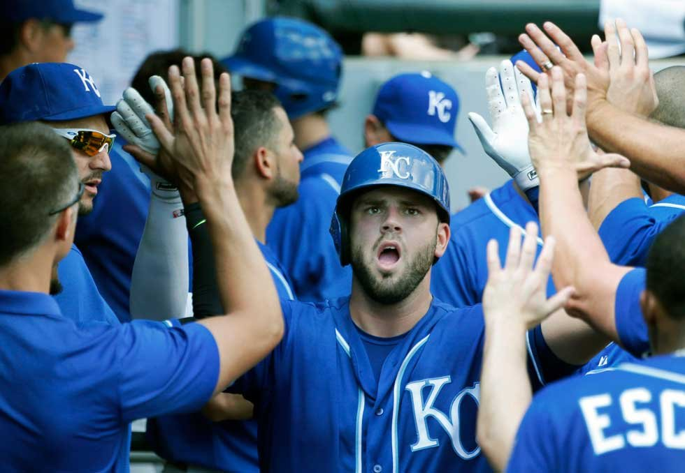 Royals players congratulate Mike Moustakas after a home-run in Friday's day game versus the Chicago White Sox (AP)