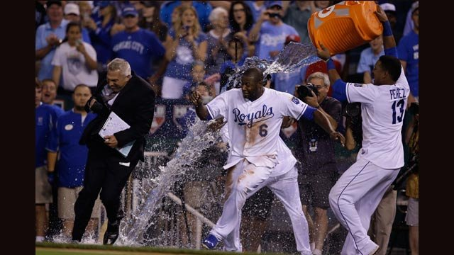 Royals' Lorenzo Cain, left, tries to dodge a cooler of water being emptied by teammate Salvador Perez (13) after a game against the Minnesota Twins at Kauffman Stadium Friday July 3, 2015. (AP Photo/Orlin Wagner)