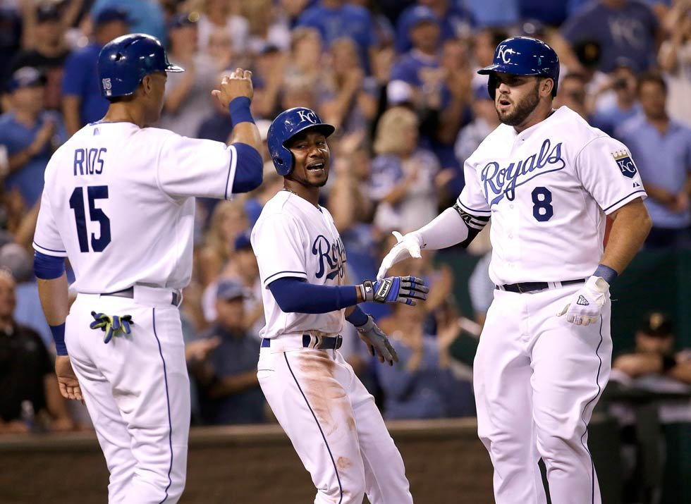 Kansas City Royals' Mike Moustakas (8) celebrates with Alex Rios (15) and Jarrod Dyson after hitting a three-run home during the seventh inning of a baseball game against the Pittsburgh Pirates Wednesday, July 22, 2015 (AP Photo/Charlie Riedel)