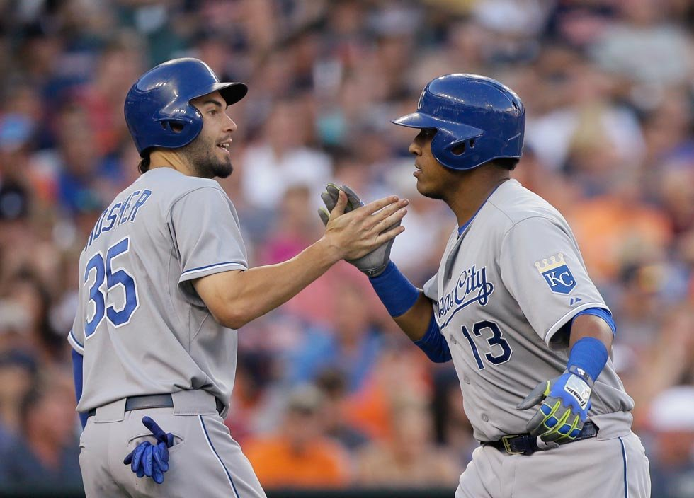 Royals' Salvador Perez (13) is congratulated by teammate Eric Hosmer after they both scored on Perez's two-run home run off Detroit Tigers starting pitcher Justin Verlander during the fourth inning of a baseball game Tuesday. (AP Photo/Carlos Osorio)