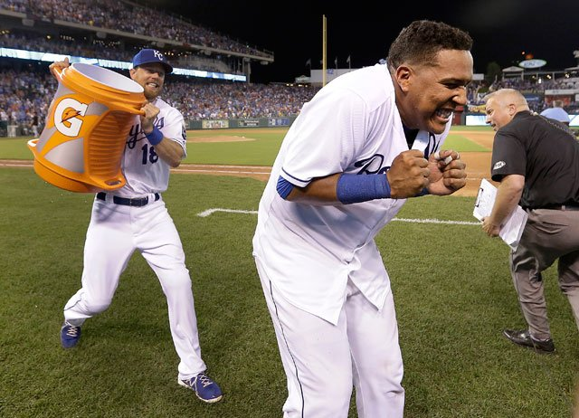 Kansas City Royals' Salvador Perez, front, braces himself to be doused by teammate Ben Zobrist after a baseball game against the Chicago White Sox, Saturday, Aug. 8, 2015, in Kansas City, Mo. The Royals won 7-6. (AP Photo/Charlie Riedel)