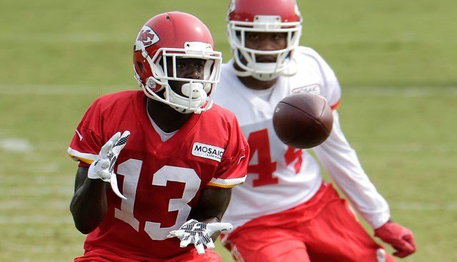 Kansas City Chiefs wide receiver De'Anthony Thomas (13) catches a pass during NFL football training camp Wednesday, Aug. 5, 2015, in St. Joseph, Mo. (AP Photo/Charlie Riedel)