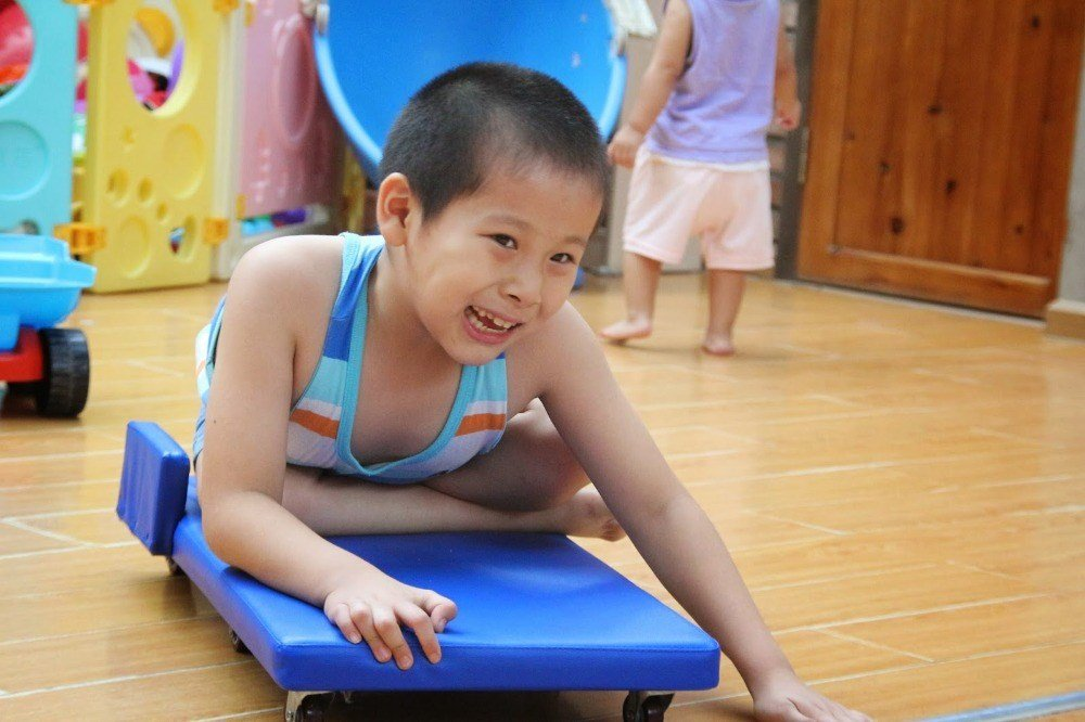 JiaJia's parents abandoned him outside a Chinese fertility clinic when he was just three months old. Botched surgery for spina bifida left him paralyzed from the waist down.