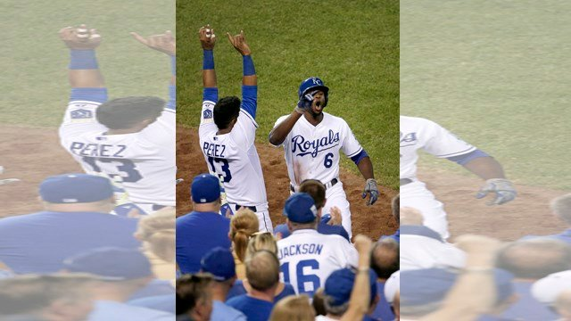 Kansas City Royals' Lorenzo Cain (6) celebrates with Salvador Perez (13) after Cain hit a solo home run during the sixth inning of a baseball game against the Detroit Tigers on Tuesday, Aug. 11, 2015, in Kansas City, Mo. (AP Photo/Charlie Riedel)