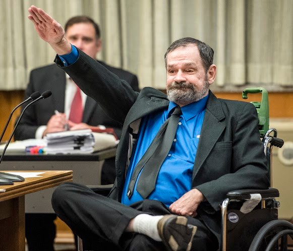 Frazier Glenn Cross Jr. gives jurors the Nazi salute after he was found guilty of killing 3 people at Jewish sites (Pool/Kansas City Star)