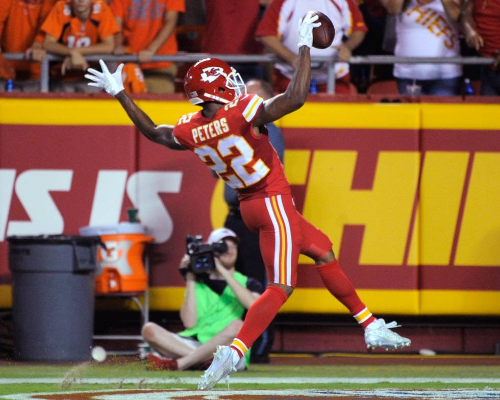 Chiefs defensive back Marcus Peters (22) celebrates his interception of a pass by Denver Broncos quarterback Peyton Manning for a touchdown during the first half of an NFL football game in Kansas City, Mo., Thursday, Sept. 17, 2015. (AP Photo/Ed Zurga)