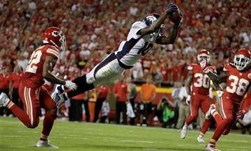Broncos wide receiver Emmanuel Sanders (10) leaps for a touchdown between Chiefs defensive backs Marcus Peters, left, Jamell Fleming (30) and Ron Parker (38) during the first half of an NFL football game in Kansas City Thursday (AP Photo/Charlie Riedel)