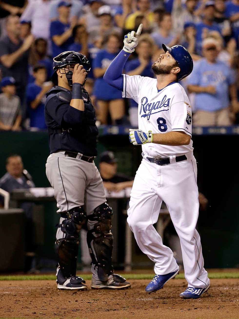 Moustakas points skyward in memory of his mother after hitting a home run on Sept. 24 (AP)