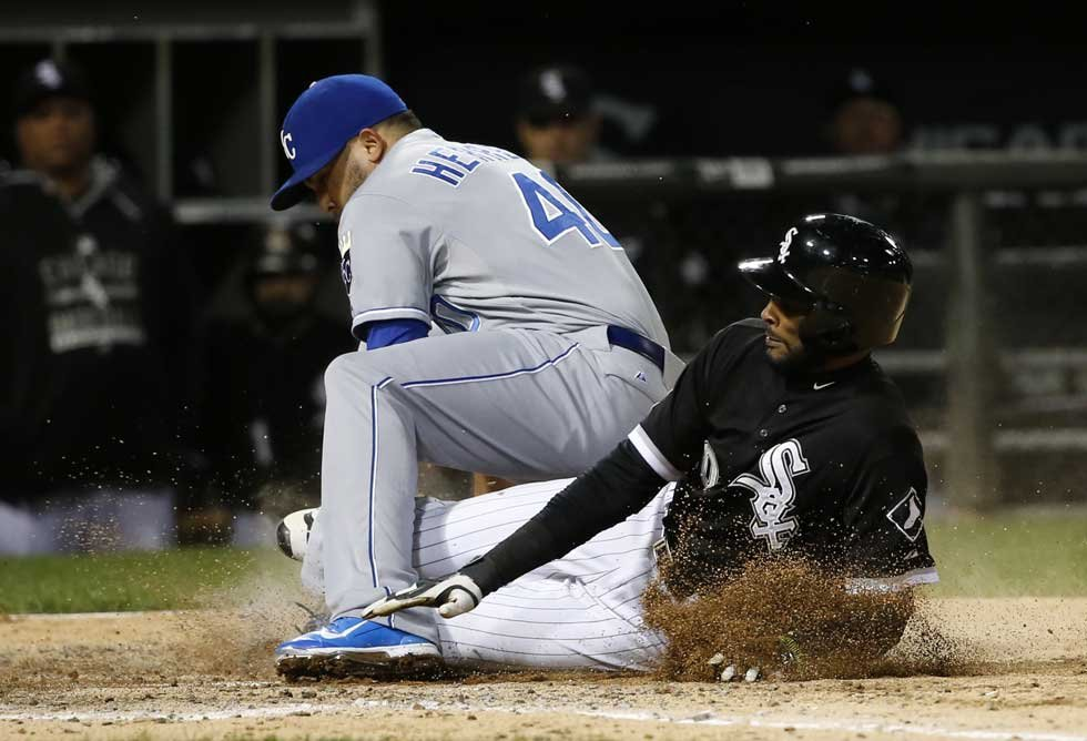 Kansas City Royals relief pitcher Kelvin Herrera, left, tags out Chicago White Sox's Alexei Ramirez at home on a throw from catcher Drew Butera, during the eighth inning of a baseball game Thursday in Chicago. (AP)