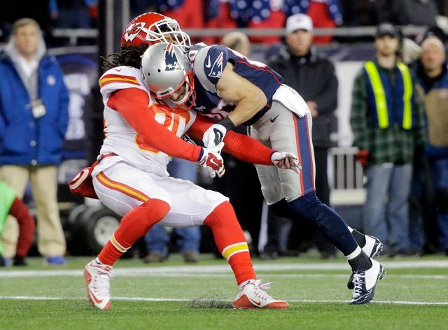 New England Patriots' Danny Amendola (80) hits Kansas City Chiefs' Jamell Fleming (30) in the first half of an NFL divisional playoff football game, Saturday, Jan. 16, 2016, in Foxborough, Mass. (AP Photo/Steven Senne)