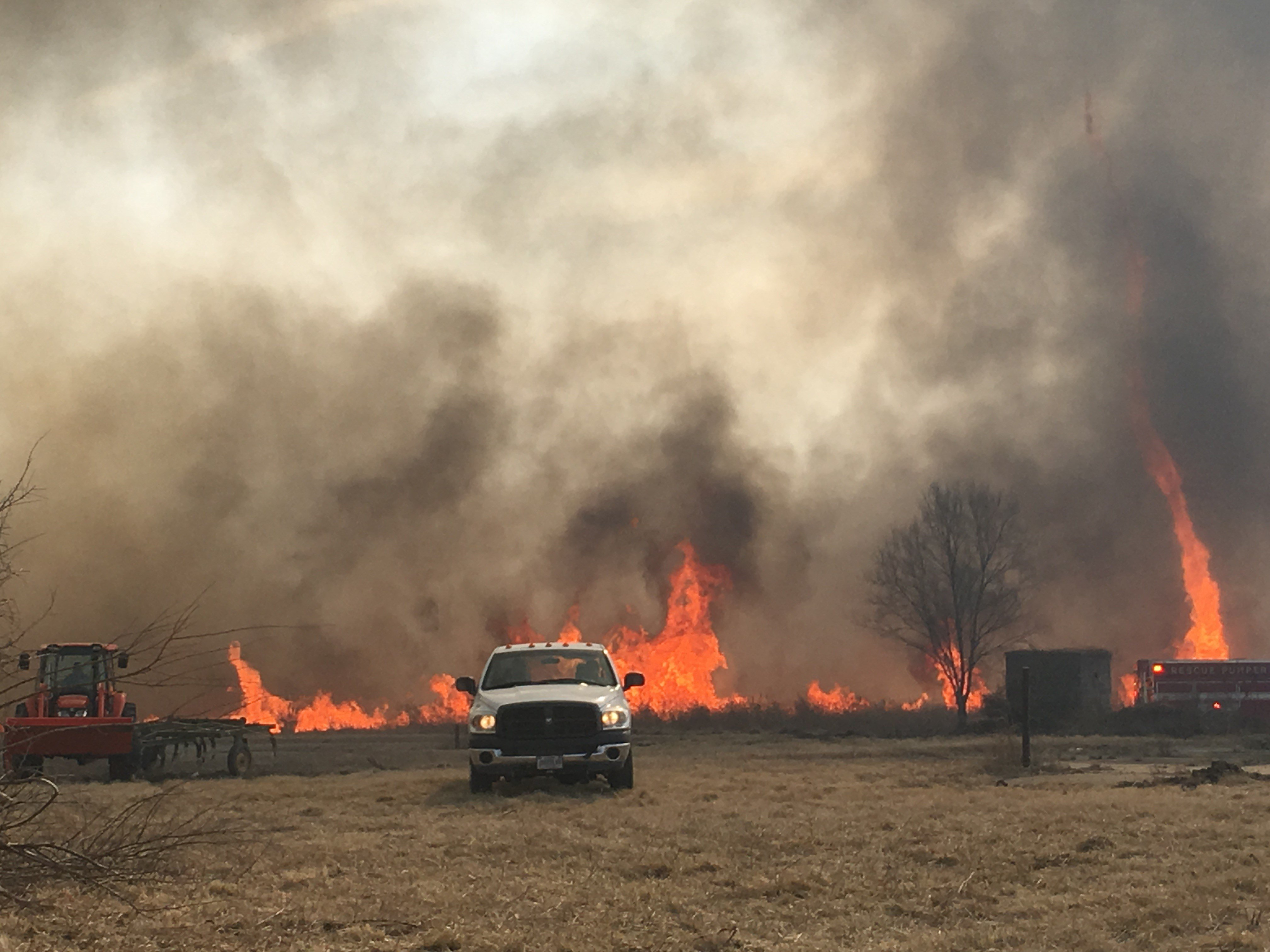 strong winds dry conditions fuel massive grass fires in platte the land is owned by the federal bureau of prisons officials said the fire started