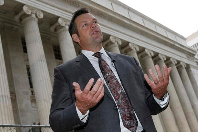 The suit, filed Tuesday, claims Kobach's Crosscheck program exposed the sensitive voter registration data, including social security numbers and signatures of nearly 1,000 Kansas voters. (AP File Photo)