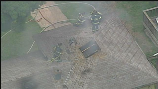 At least one hurt, 2 dogs dead after house fire in Kansas City